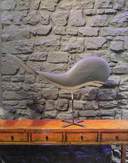 Wooden whale on stand
