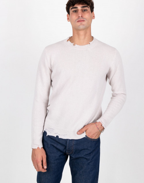 Ripped ivory coloured wool shirt