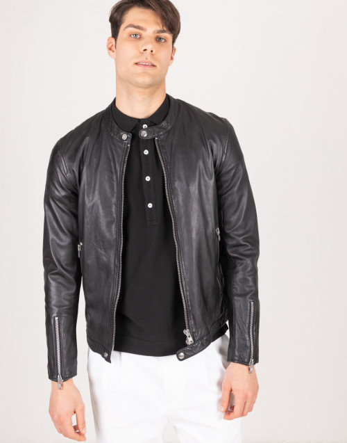 Black leather jacket with zip on the cuffs