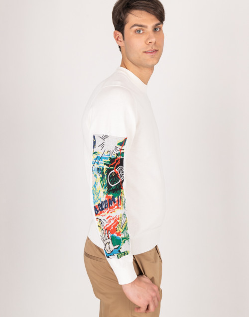 Ivory sweater with pattern on the sleeves