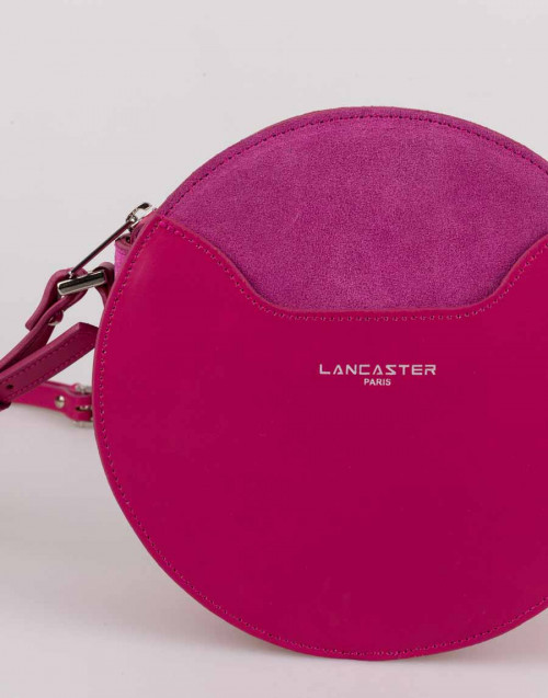 Pink round bag with suede detail