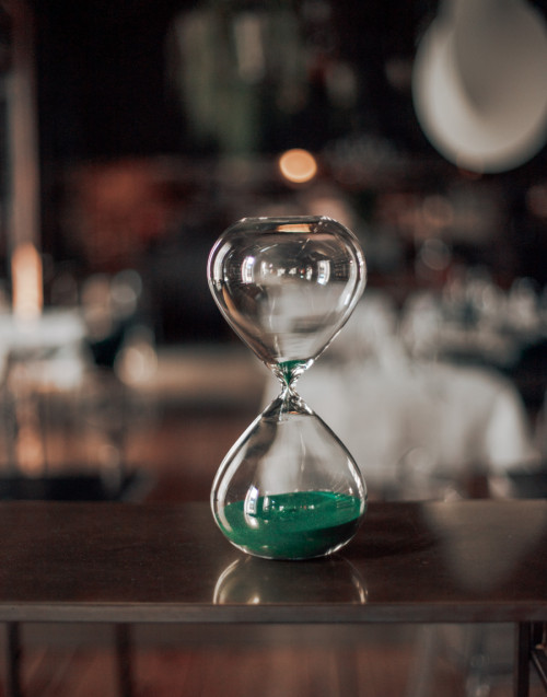 Large hourglass with green sand