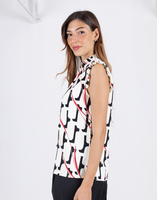 White sleeveless top tape with red pattern