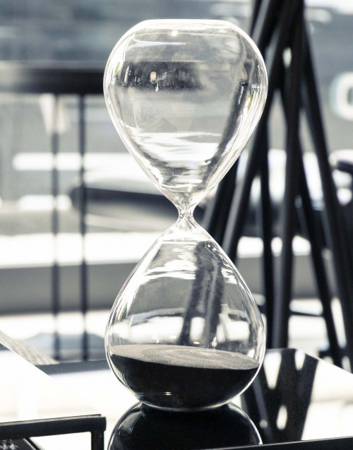 Large hourglass with black sand