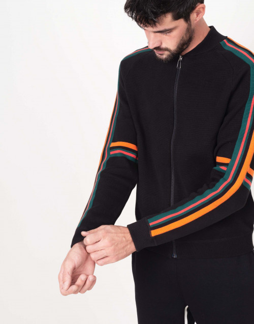 Black sweatshirt with orange and green patch