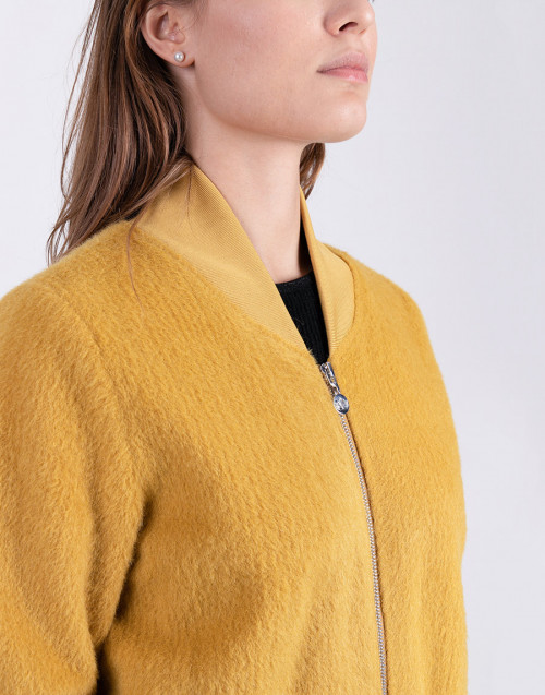 Ocher color bomber jacket